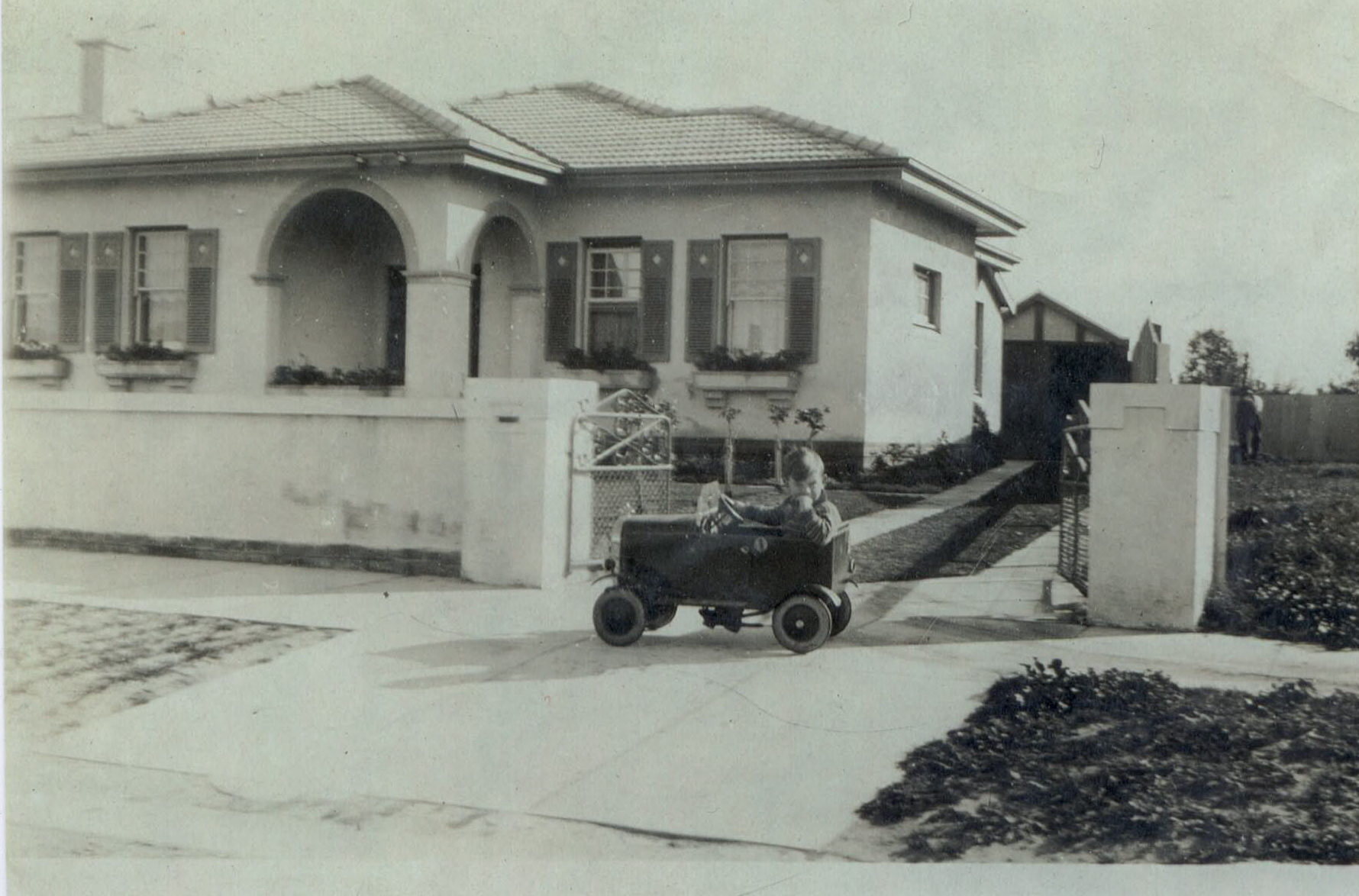 4 Raynes Street, Caulfield about 1933. Brian Norbury in peddle car