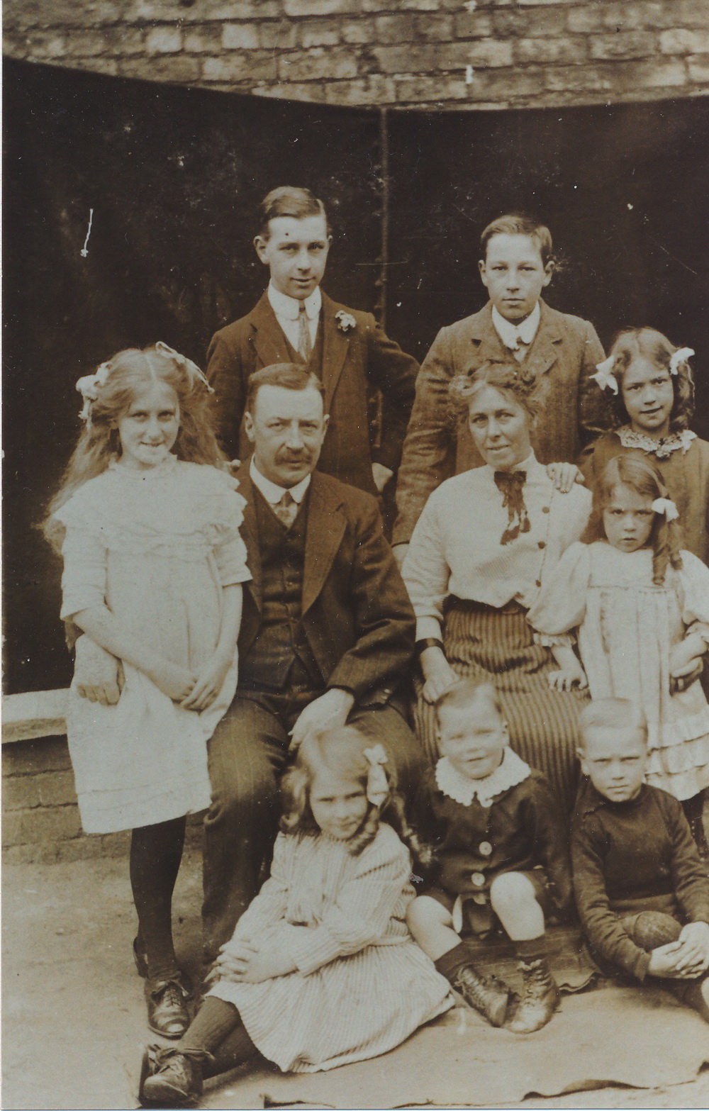 Pye Family photograph ca 1912. Standing (from left): Harry, William; Middle row (from left): Gertrude, Thomas, Mary, Anne, May; Seated at front (from left): Mary, Frank, Thomas