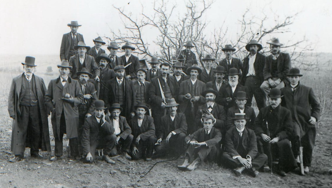 Pruning competition. Frank Petty is back row second from left, to right of highest man in row
